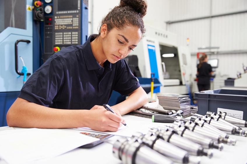 Woman engineer using a CNC machine