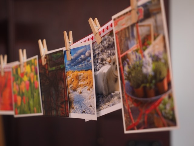 photographs drying on a wire